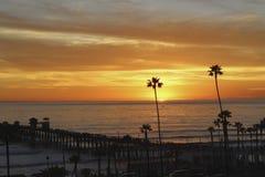Sunset Oceanside pier California. Orange sun setting at Oceanside pier California Royalty Free Stock Photography
