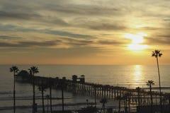 Sunset Oceanside pier California. Yellow sun setting at Oceanside pier California Royalty Free Stock Photos