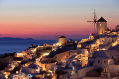 Sunset in Oia, Santorini. At the northern end of Santorini Island there`s the little town Oia from where beautiful sunsets can be admired. The white houses Stock Photography