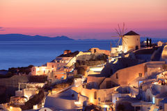 Sunset in Oia, Santorini. At the northern end of Santorini Island there`s the little town Oia from where beautiful sunsets can be admired. The white houses Stock Image