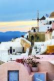 The sunset in Oia town and tourists enjoying their vacation Royalty Free Stock Photography