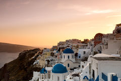 The sunset at Oia village in Santorini island in Greece.  Stock Photo