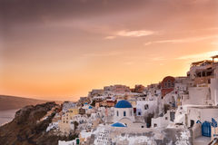 The sunset at Oia village in Santorini island in Greece Stock Images