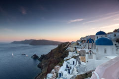 The sunset at Oia village in Santorini  Stock Photos