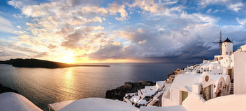 Sunset in Oia village on Santorini island, Greece. Beautiful Santorini island in Greece. Traditional apartments and windmills in Oia village on a sunset Stock Image