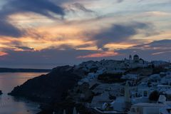 Sunset in Oia village on Santorini island. Greece Royalty Free Stock Photography