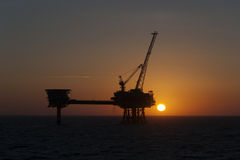 Sunset and Oil platform. Sunset next to a Oil platform in the North Sea. Photo taken June 2013 Stock Photos