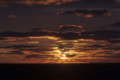 Sunset and Oil platform royalty free stock photography