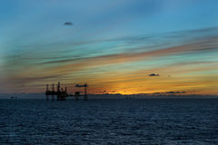 Sunset and Oil platform royalty free stock photos