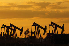 Sunset oil pump jack Royalty Free Stock Photo