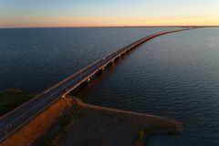 Sunset at the Oland bridge. Aerial view during sunset of the Oland bridge crossing the Kalmar straight viewed from the island Oland to mainland Sweden royalty free stock images