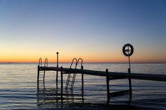 Sunset by the old bath pier Royalty Free Stock Images