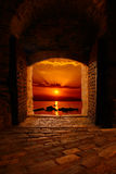 Sunset through the old castle Royalty Free Stock Photography
