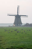 Sunset with old Dutch windmill Royalty Free Stock Photo