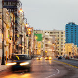 Sunset in Old Havana with  the street lights of El Malecon. And light trails from the passing cars Stock Image