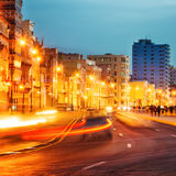Sunset in Old Havana with  the street lights of El Malecon. And light trails from the passing cars Stock Photography