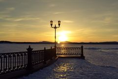 Sunset. Old lantern on the lake, sunset Royalty Free Stock Photo