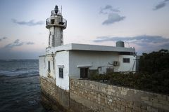 Sunset at old lighthouse in Tyre, Sour, Lebanon Stock Photos