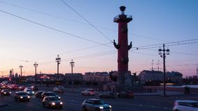 Sunset on old Saint Petersburg Stock Exchange square, Russia. Rostral column. Evening traffic of cars time lapse stock footage