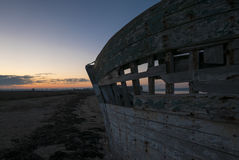Sunset and old shipwreck in Arz Island in Brittany Morbihan, F Royalty Free Stock Images