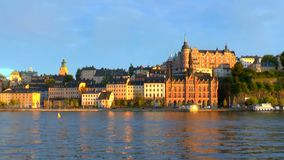 Sunset in the Old Town in Stockholm, Sweden. Scenic summer zoom panorama of sunset in the Old Town pier architecture in Sodermalm district of Stockholm, Sweden stock video footage