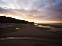 Sunset in Omaha Beach Royalty Free Stock Image