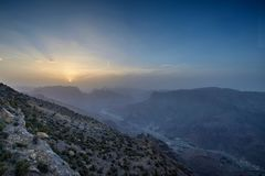 Sunset in the Omani mountains. Sunset in the mountains in the Kingdom of Oman. Location Al Jebal Akhdar Sunset with mountain in the foreground and valley on the stock images