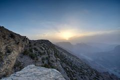 Sunset in the Omani mountains. Sunset in the mountains in the Kingdom of Oman. Location Al Jebal Akhdar Sunset with mountain in the foreground and valley on the royalty free stock photo