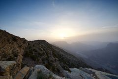 Sunset in the Omani mountainsS. Sunset in the mountains in the Kingdom of Oman. Location Al Jebal Akhdar Sunset with mountain in the foreground and valley on the stock photo