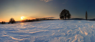 Sunset On Frozen Field. Stock Images