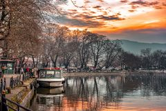 Free Sunset On Lake Pamvotis. Docked Boat Ready To Transfer People To The Small Island. Greece. Royalty Free Stock Photography - 148040787