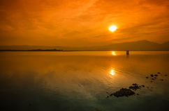 Sunset On The Lake Against The Sky In The Clouds. Royalty Free Stock Photo