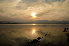 Sunset On The Lake Against The Sky In The Clouds. Stock Photos