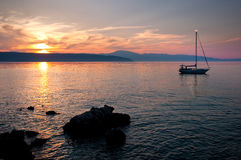Sunset On The Sea At Glavotok With Sailing Boat - Krk - Croatia Stock Photography