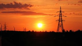 Sunset, orange sky and electrical lines Stock Photography