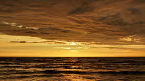 Sunset and storm clouds Stock Photography