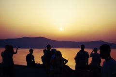Sunset. In orange color with people Stock Photography