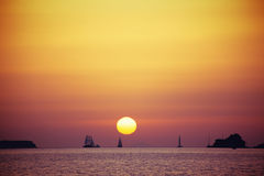 Sunset. In orange color on the sea near santorini island with boats on horizont Royalty Free Stock Photos