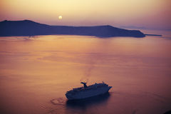 Sunset. In orange color on the sea near santorini island with boats on horizont Royalty Free Stock Photo