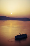 Sunset. In orange color on the sea near santorini island with boats on horizont Stock Photos