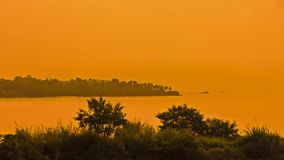 After sunset orange glow over the sun and sea, with silhouette Royalty Free Stock Image