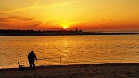 Sunset orange sky and Fisherman Royalty Free Stock Photography