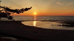 Sunset sunny beach Stock Photography