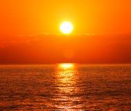Sunset with orange sun Stock Photo
