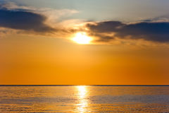 Sunset in orange tones over a sea Royalty Free Stock Photos