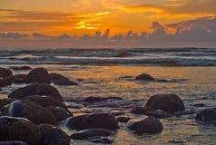 Sunset on the Oregon Coast 1. The sun is setting on the rocky beach of Seaside on the Oregon Coast Royalty Free Stock Photography