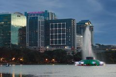 Sunset at Orlando Downtown in Lake Eola Park with water fountain and city skyline stock images