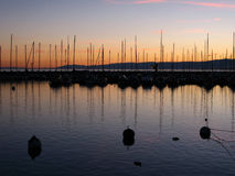 Sunset in Ouchy marina 07 Lausanne, Switzerland. Sunset colors reflecting in the water of Lake Geneva (Leman) in port of Ouchy, Lausanne, Switzerland Stock Photo
