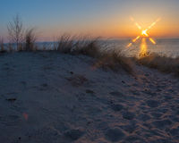 Sunset at Oval Beach Saugatuck. Michigan in spring of 2015 with calm waves and clear sky stock photos
