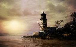 Sunset over abandoned lighthouse Stock Photography
